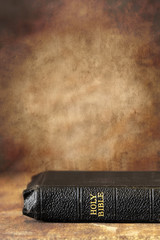 Bible with Grunge Stone Background