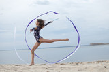 Young gymnast girl dance with ribbon