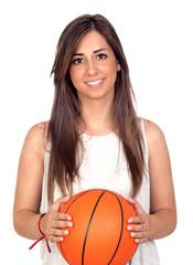 Atractive girl with a basketball ball