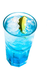 glass of blue cocktail with lime on white background