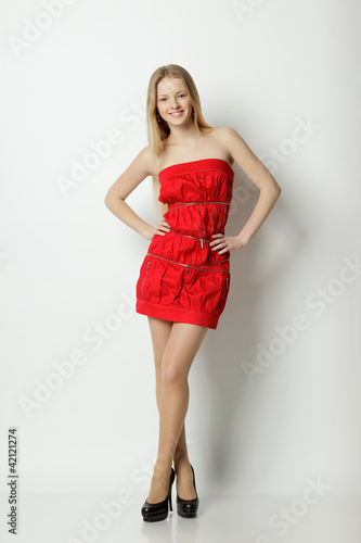 Full length of cheerful female fashion model posing