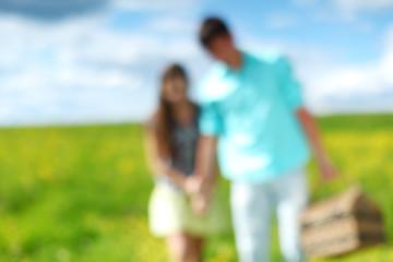 man and woman walk on picnic