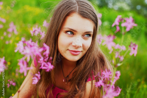 woman on summer flower field