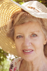 pretty older lady in sun hat