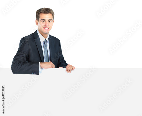Happy smiling young business man showing blank