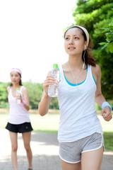 Beautiful young women running in park. Portrait of asian.
