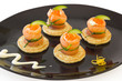 Red salmon rolls with cheese, caviar and cucumber