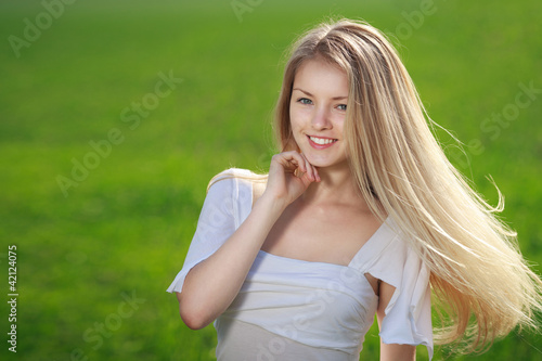 Closeup of young beautiful blond woman outdoors