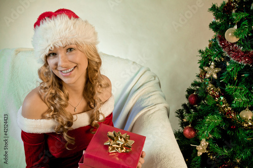 Young woman enjoying her Christmas gift