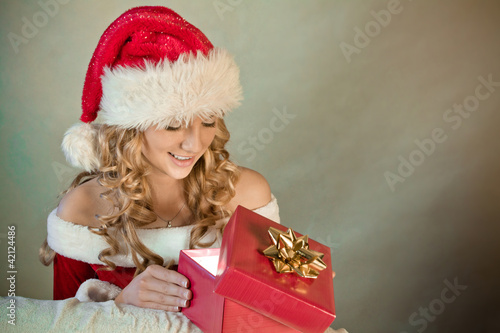 Portrait of a beautiful woman in santa hat smiling