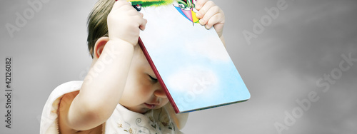 little cute girl with a book