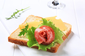 Bread with Swiss cheese and salami