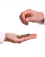 Male hand giving a euro coin to another person