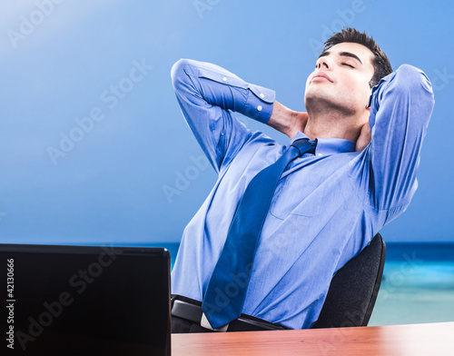 Businessman dreaming holiday