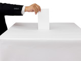 Gentleman hand putting a voting ballot in slot of white box isol