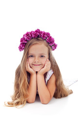 Little girl with pink violet floral wreath