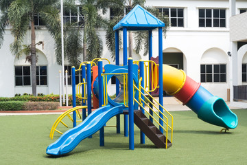 Playground on green grass and outdoor