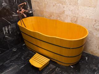 Wooden bathtub in a bathroom