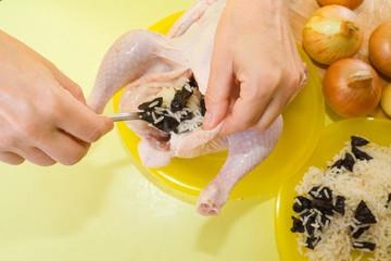 Closeup of  making stuffed chicken