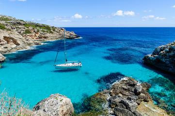 Sailing boat at anchor. Paradise wild bay. Cala Marmolis.