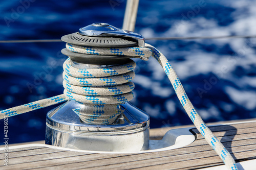 Sailing boat winch with rope closeup