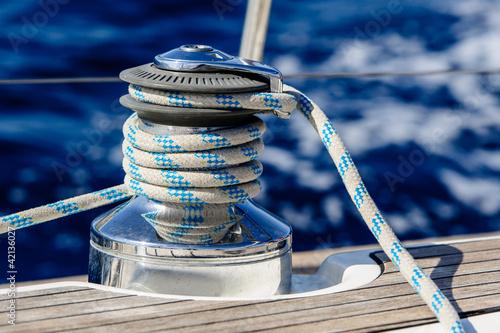 Leinwanddruck Bild Sailing boat winch with rope closeup