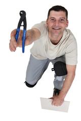 Man preparing to cut tile