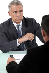 Businessman listening to a colleague