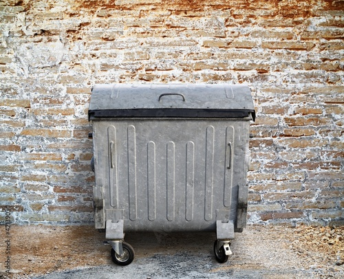 garbage container with brick wall setting