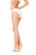female legs in white bikini panties