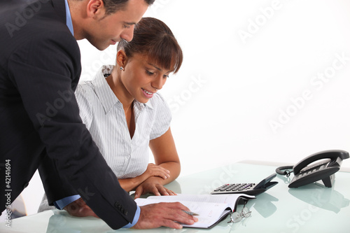 Secretary showing boss his schedule