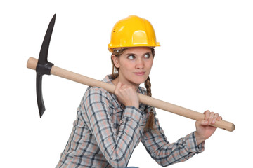 Female laborer with pickaxe on white background
