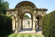 decorative arched way with statues