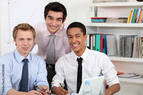 Young men at a computer