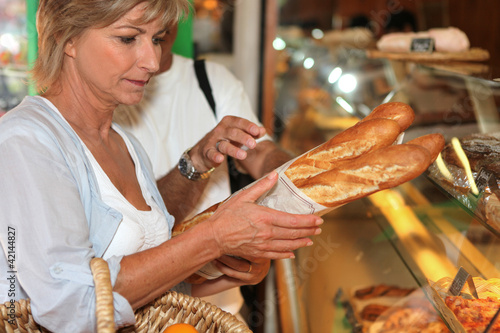 Woman buying bread