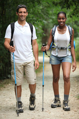 Couple hiking through countryside