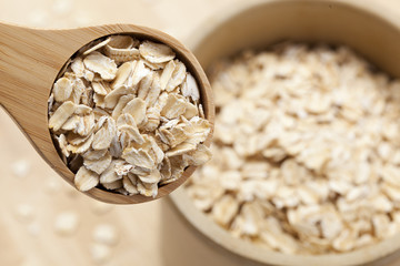 Healthy Dry Oatmeal in a wooden spoon