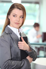 Businesswoman clutching at important document