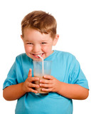 Happy smiling child drinking chocolate milk