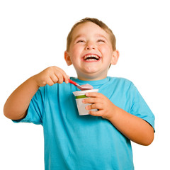Happy smiling young child eating yogurt