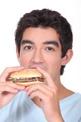 Man eating cheeseburger