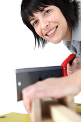 female carpenter all smiles at work