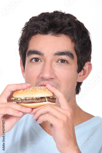 Man eating cheeseburger