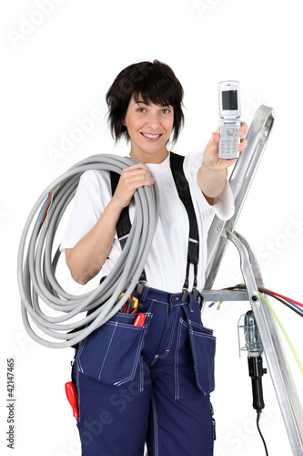 Female plumber isolated on white background