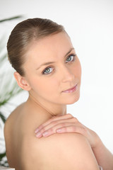 Young woman in a towel looking over her shoulder