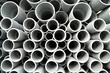 Leinwanddruck Bild - Gray plastic pipes stacked