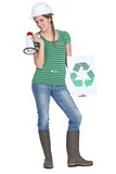 crafswoman holding loudspeaker shows recycling logo