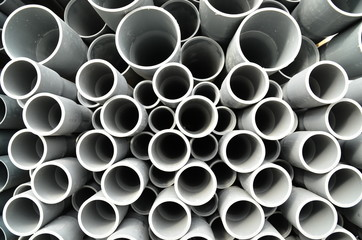 Gray plastic pipes stacked
