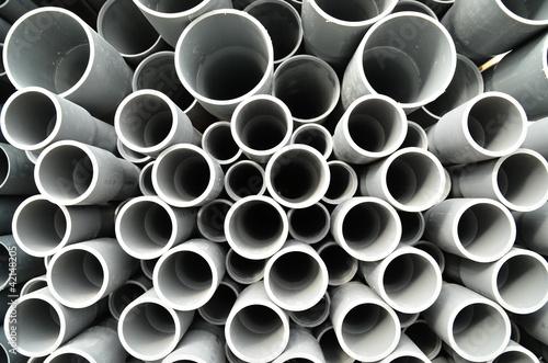 Leinwanddruck Bild Gray plastic pipes stacked