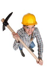 Woman with a helmet holding a pickaxe